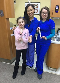 Dr. Wang dental assistant and young patient
